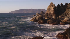 Stock Video Footage of Close flight past rocks on the rugged Catalina coast. Shot in 2010.