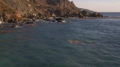 Stock Video Footage of Over jagged rocks along the Catalina coast. Shot in 2010.