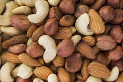 almonds, hazelnuts, cashews nuts mixed together - stock photo