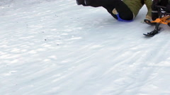 Snow racing in a wintery park Stock Footage