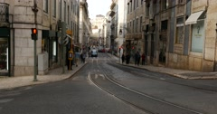 Classic Yellow Tram (electric) in Baixa Lisbon, Portugal Stock Footage