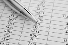 Financial statements. Ballpoint pen on financial statements - stock photo
