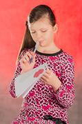 Girl writes, composes a love letter. - stock photo