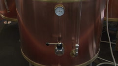 Looking at beer brewing kettle Stock Footage