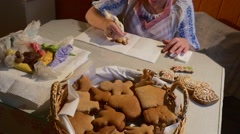 Hands Are Decorating an Angel-Cookie Woman Putting a Mastique Christmas Cookies Stock Footage