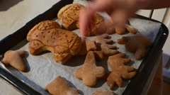 Female Hand is Putting a Ram Shaped Angel Shaped Cookies Baked Biscuits on a Stock Footage