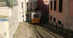Tram 28 in famous Bica funicular, near Bairro Alto, Lisbon, Portugal Stock Footage