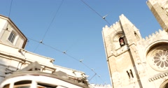 Santa Maria Maior or Se Cathedral and Tram in Alfama, Lisbon, Portugal Stock Footage