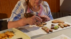 Woman is Painting a Cookie With Brown Mastique Woman is Decorating a Christmas Stock Footage