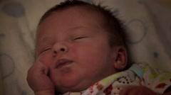 Newborn infant waking up - stock footage