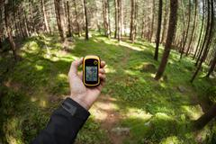 Finding the right position in the forest via gps Stock Photos