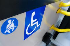 reserved seat label onboard bus for disabled people - stock photo