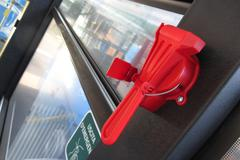 Red evacuation hammer on public transport Stock Photos