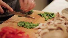 Top and tailing green beans Stock Footage