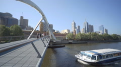 Tour boat crusing along Yarra River in downtown Melbourne, Australia Stock Footage