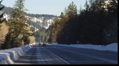 Vehicles on a mountain highway in winter Stock Footage