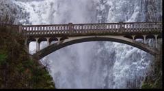 Benson Bridge in front of icy Multnomah Falls Stock Footage
