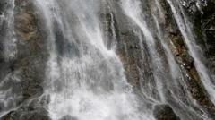 Cascading waterfall splashing down a rocky slope Stock Footage