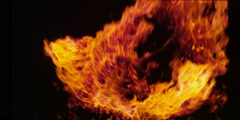 Swirling flames, constantly renewed from below, circle the perimeter of the Stock Footage