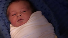 A swaddled newborn infant Stock Footage