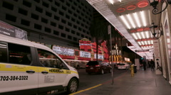 People walking past Fremont St. taxi stand at night Stock Footage