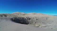 Kelso Sand Dunes In Mojave Desert Wide Pan With Sun Stock Footage