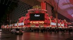 Crowds crossing street in Old Town Las Vegas at night Stock Footage
