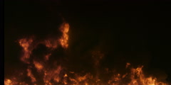 Black smoke and swirling flames gradually rise to fill the frame - stock footage