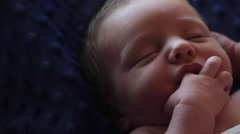 Newborn infant self soothing - stock footage