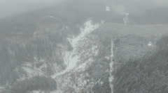 flight at high altitude over the winter forest - stock footage