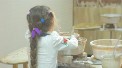 Girl is Molding a Clay by Spatula Kid's Back Rotating a Pottery Wheel Little Stock Footage