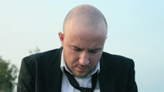 Sad man, black suit and tie Stock Footage