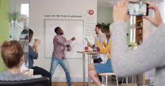 Crazy happy african american businessman dancing doing victory dance in team - stock footage