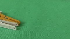 Clothespin on green background Stock Footage