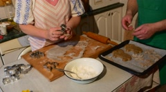 Couple is Pressing Out The Biscuits Using a Mold Pastry Mold and Putting Them Stock Footage