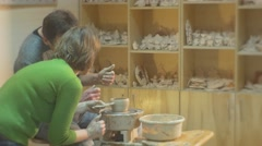 Potter Teacher Explains to a Student How to Work with Clay Man is Molding a Stock Footage