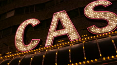 Pan to neon casino sign Stock Footage