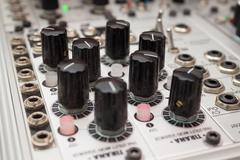 analog synthesizer , knobs macro on music equipment - stock photo