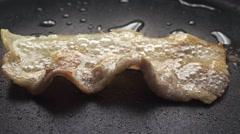 Macro shot of frying bacon slice Stock Footage