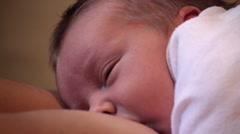 Newborn infant breastfeeding - stock footage
