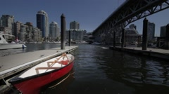 A Canoe  docked at Granville Island - stock footage