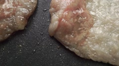 Frizzling bacon on a non stick frying pan, macro video Stock Footage