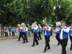 Blurred photo of Marching orchestra during parade Stock Photos