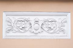 ancient decorative marble ornamental on the wall - stock photo