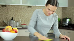 Young woman having back pain during cleaning the counter in the kitchen HD Stock Footage