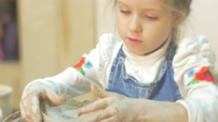 Kid is Molding an Edges of Clay Circle Sculpting a Vase Little Blonde Girl is Stock Footage