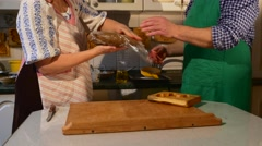 People Are Packing a Brown Dough Man Removes Pastry Husband in Green Apron Stock Footage