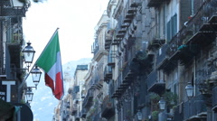 Italian flag hanging over street in Palermo, Sicily, Italy. Stock Footage