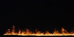 Low flames across the bottom of the frame grow higher - stock footage