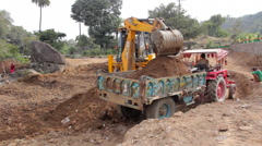 Excavator working at a construction site in India Stock Footage